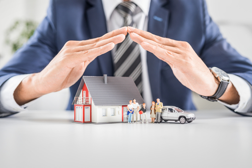An agent protecting your home with insurance